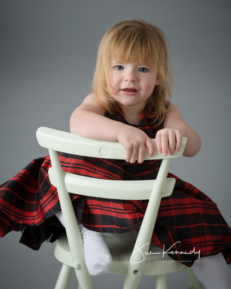 Children's Portrait Awards 2018 - photograph of a girl sitting on a chair to promote charity portrait sessions with Sue Kennedy Photography ltd.