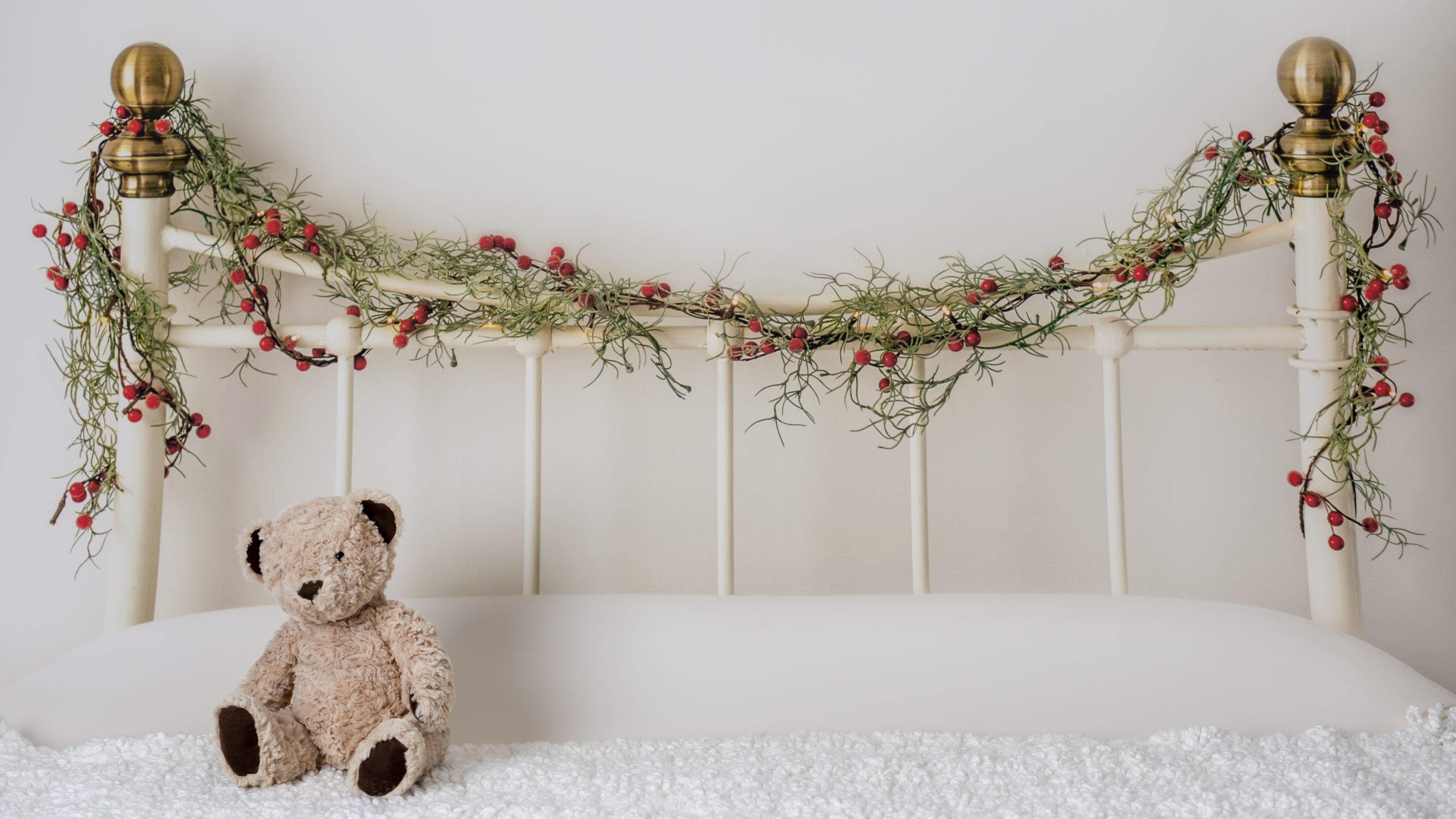 Christmas themed styling on a wrought iron bed