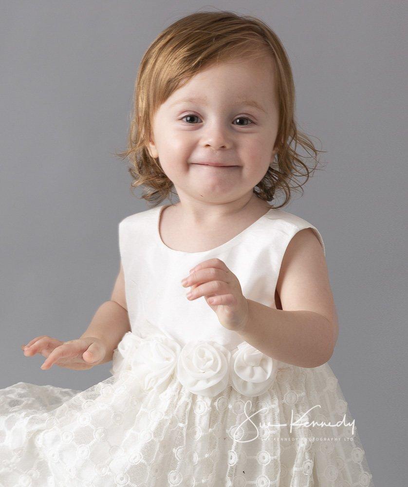 toddler girl smiling to camera