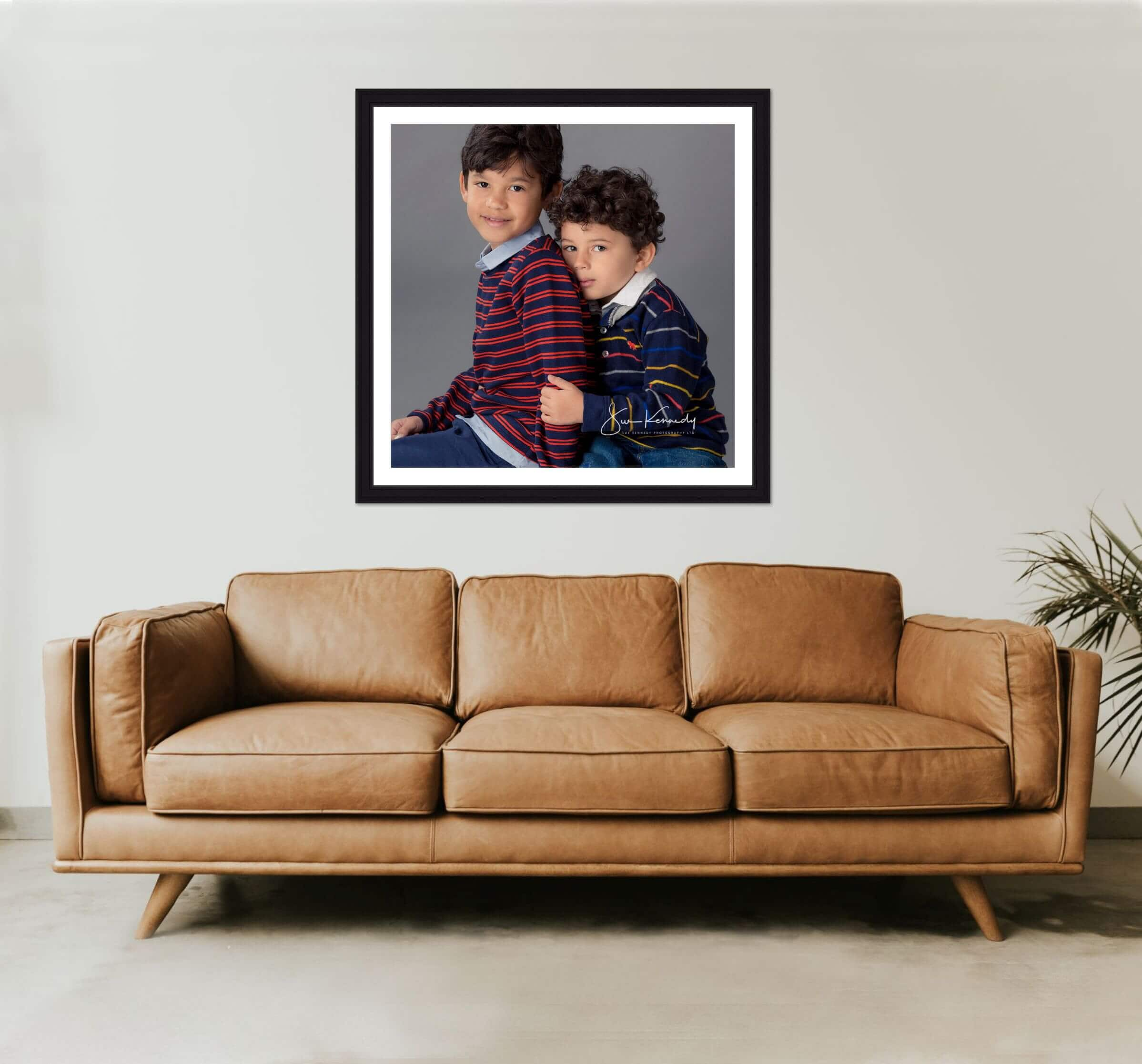 living room scene with framed wall art