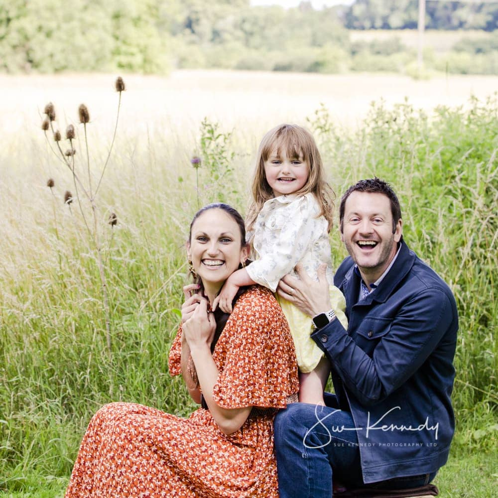 Outdoor family photography with parents and 4 year old in grasses